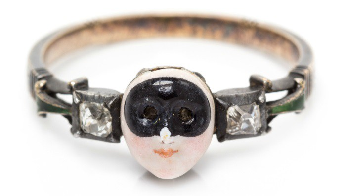 A rare 18th century Carnival mask locket ring. This treasure features a secret compartment and the message 'SOVS LE MASQVE LA VERITE' which means 'Under the mask, the truth.'