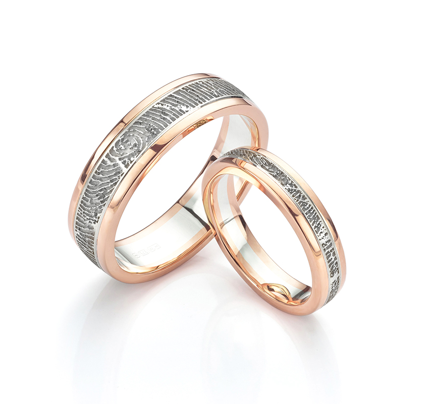 Inlaid white and rose gold wedding rings with fingerprint