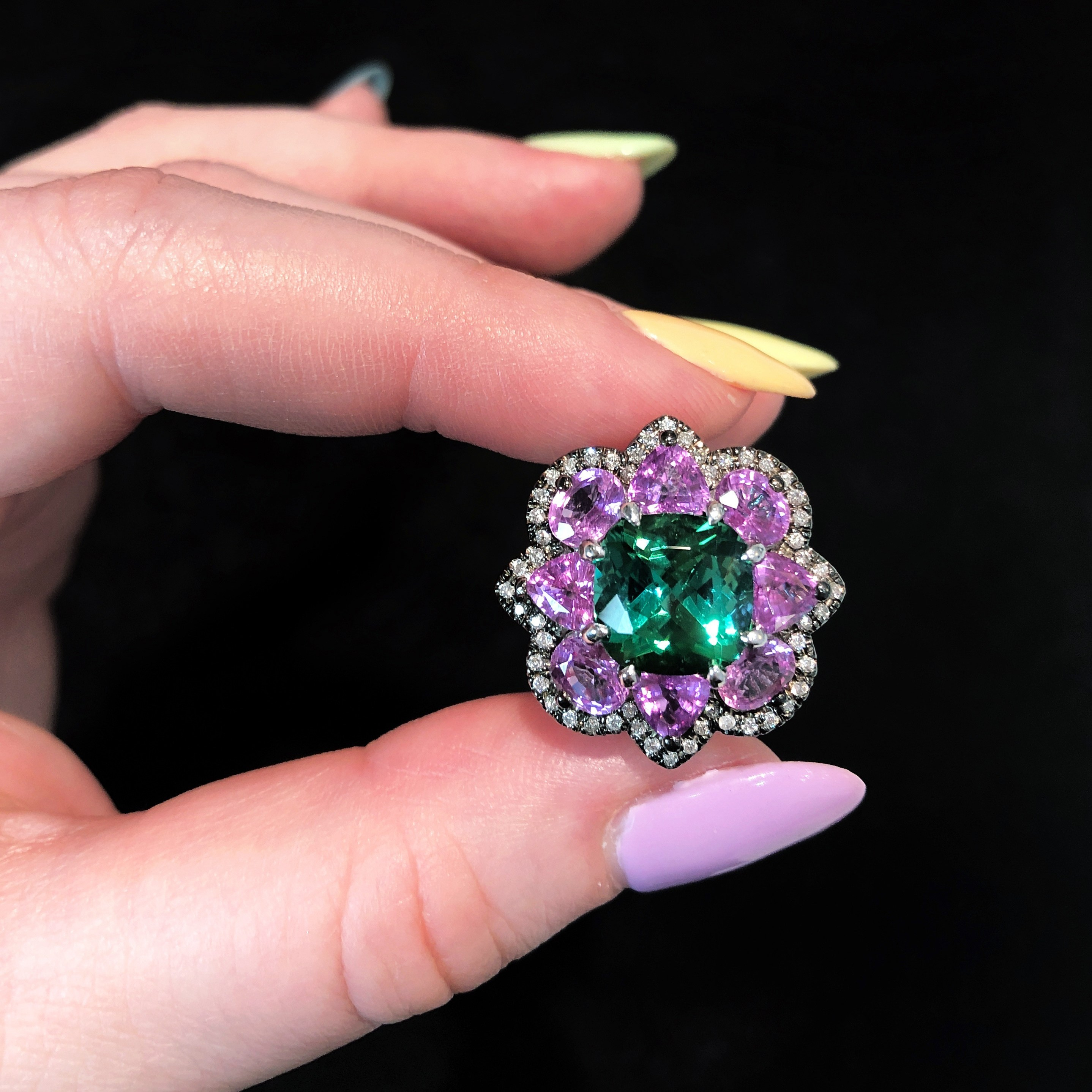 A beautiful tourmaline, sapphire, and diamond ring by Campbellian Collection. Spotted at AGTA GemFair 2019.