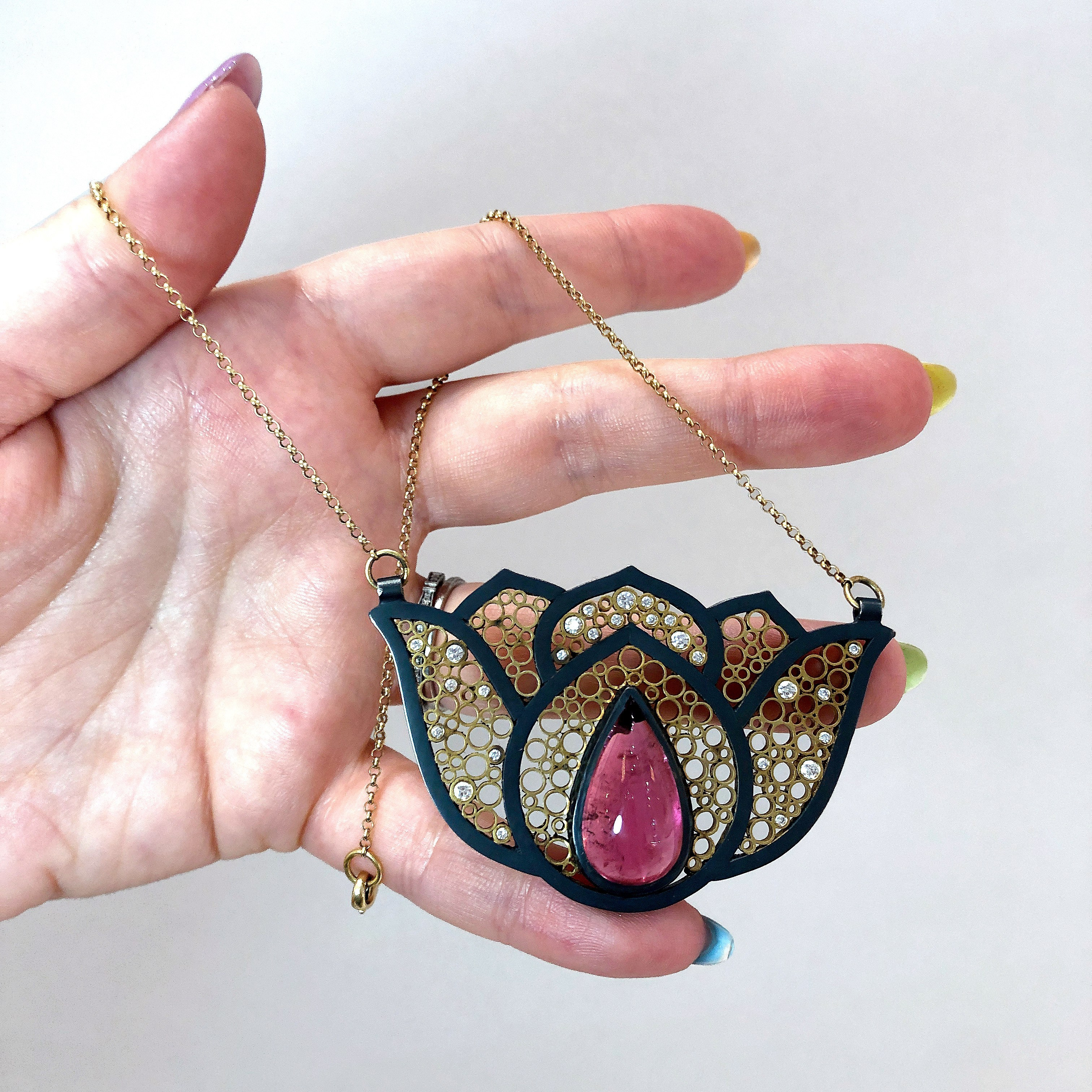 A stunning Belle Brooke Designs necklace with recycled gold and a pink tourmaline.