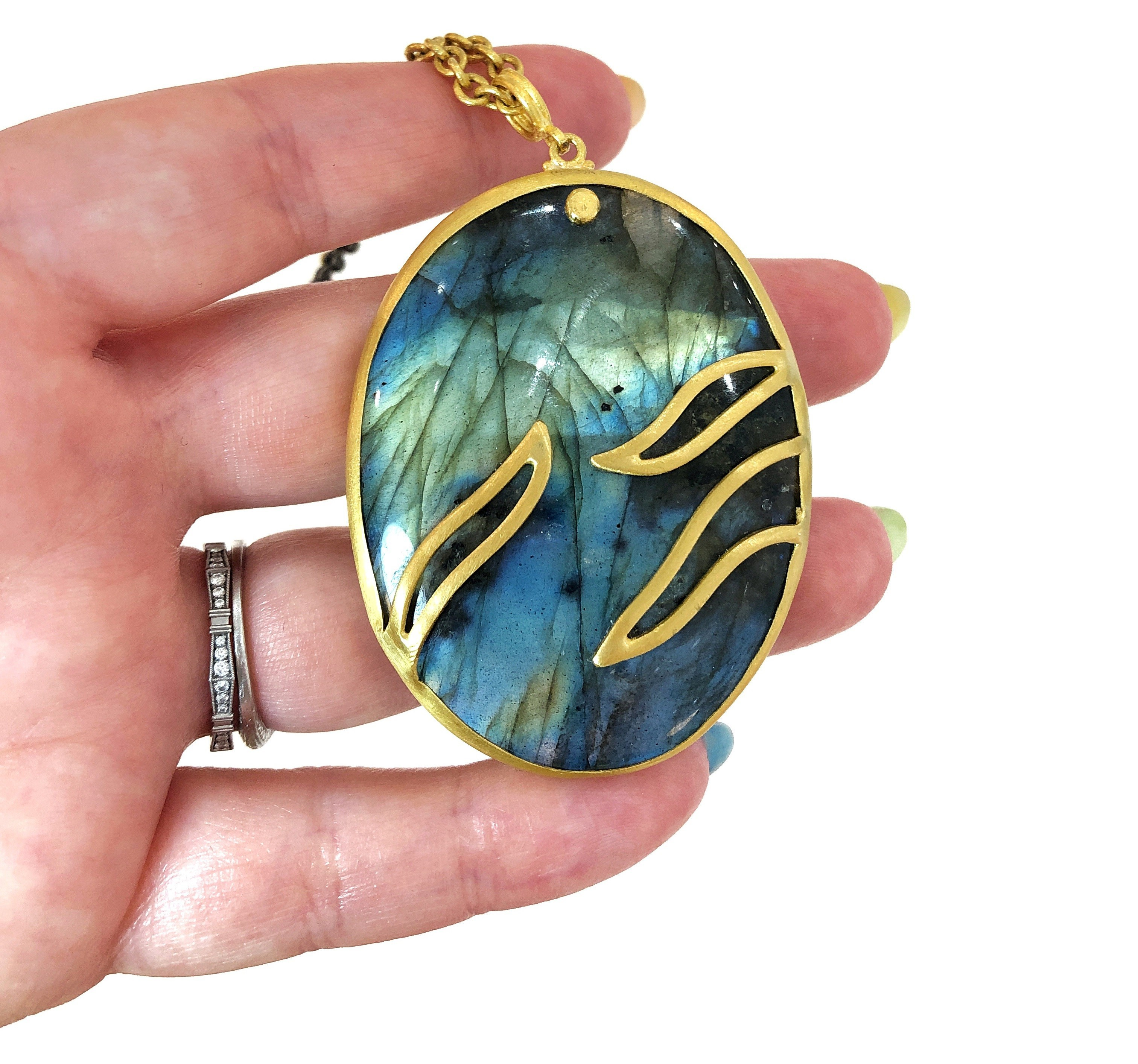 An exquisite labradorite and gold pendant necklace by Lika Behar.