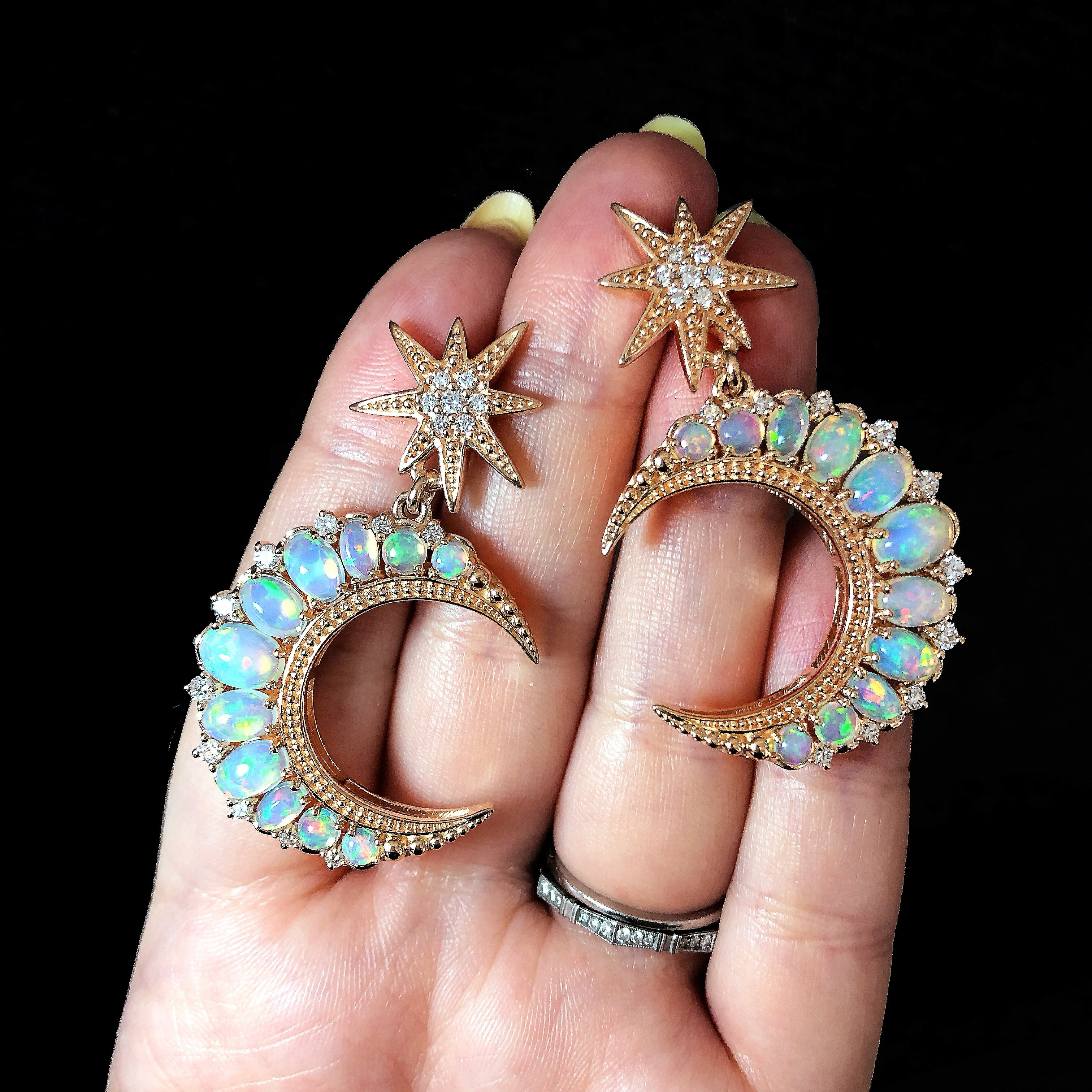 I love these rose gold and opal crescent moon earrings by Dallas Prince Designs.