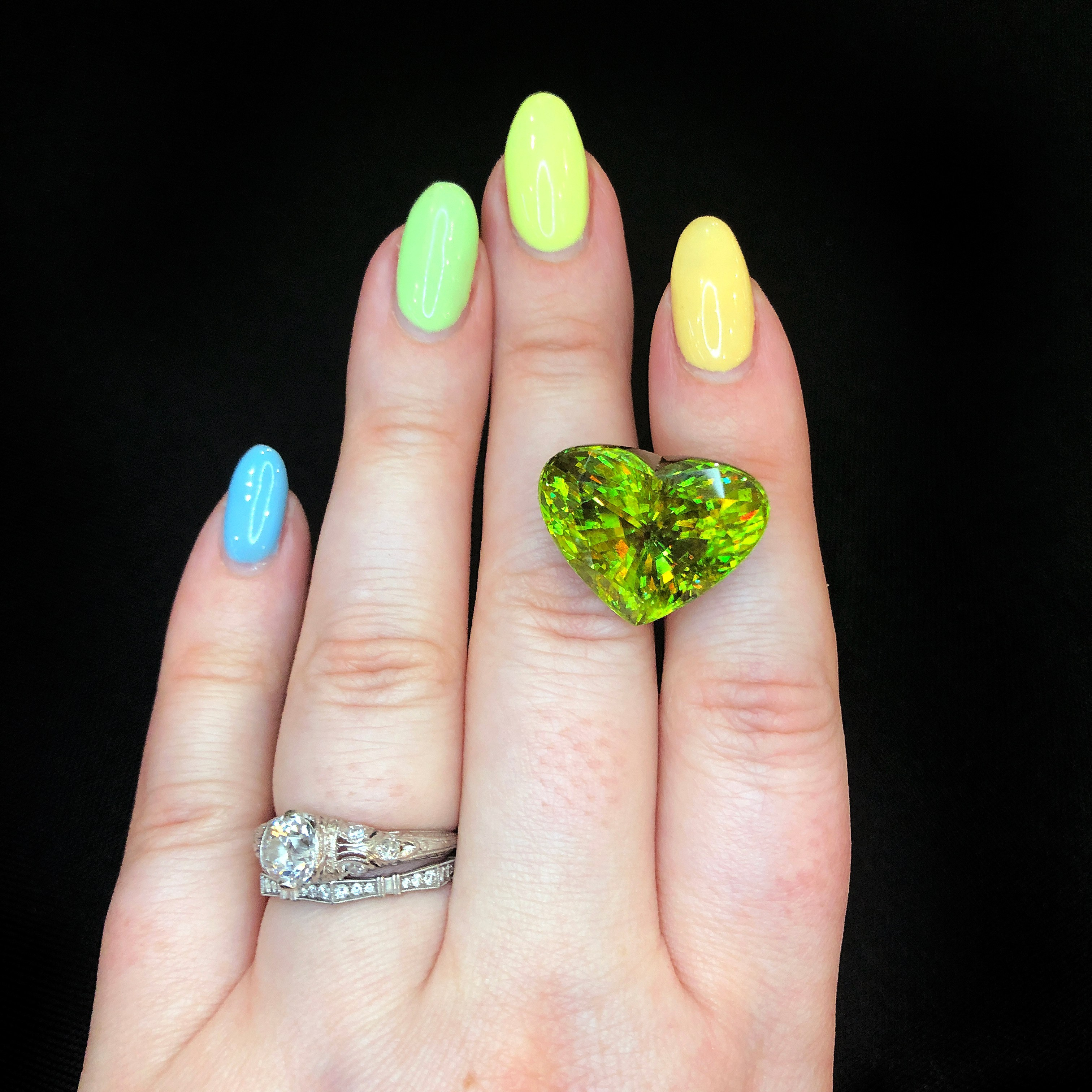 Sphene is a stunning green gemstone with orange flecks. This heart-shaped beauty is from Michael Couch.