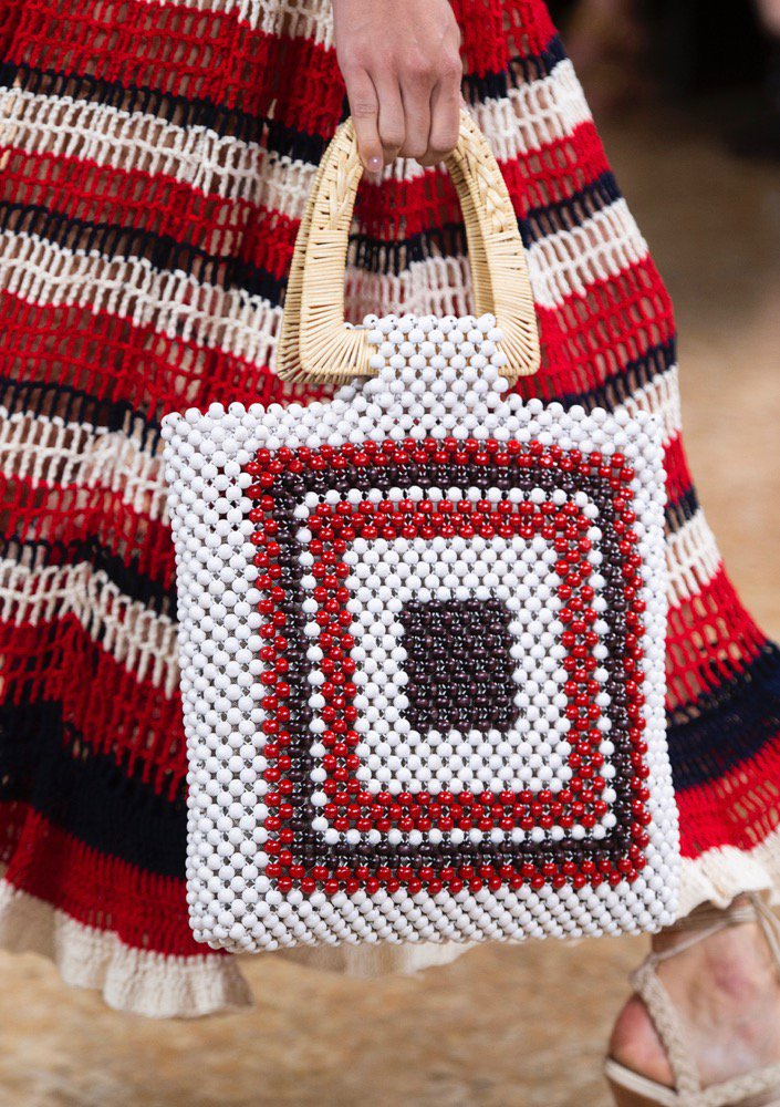 A beaded bag on the runway.