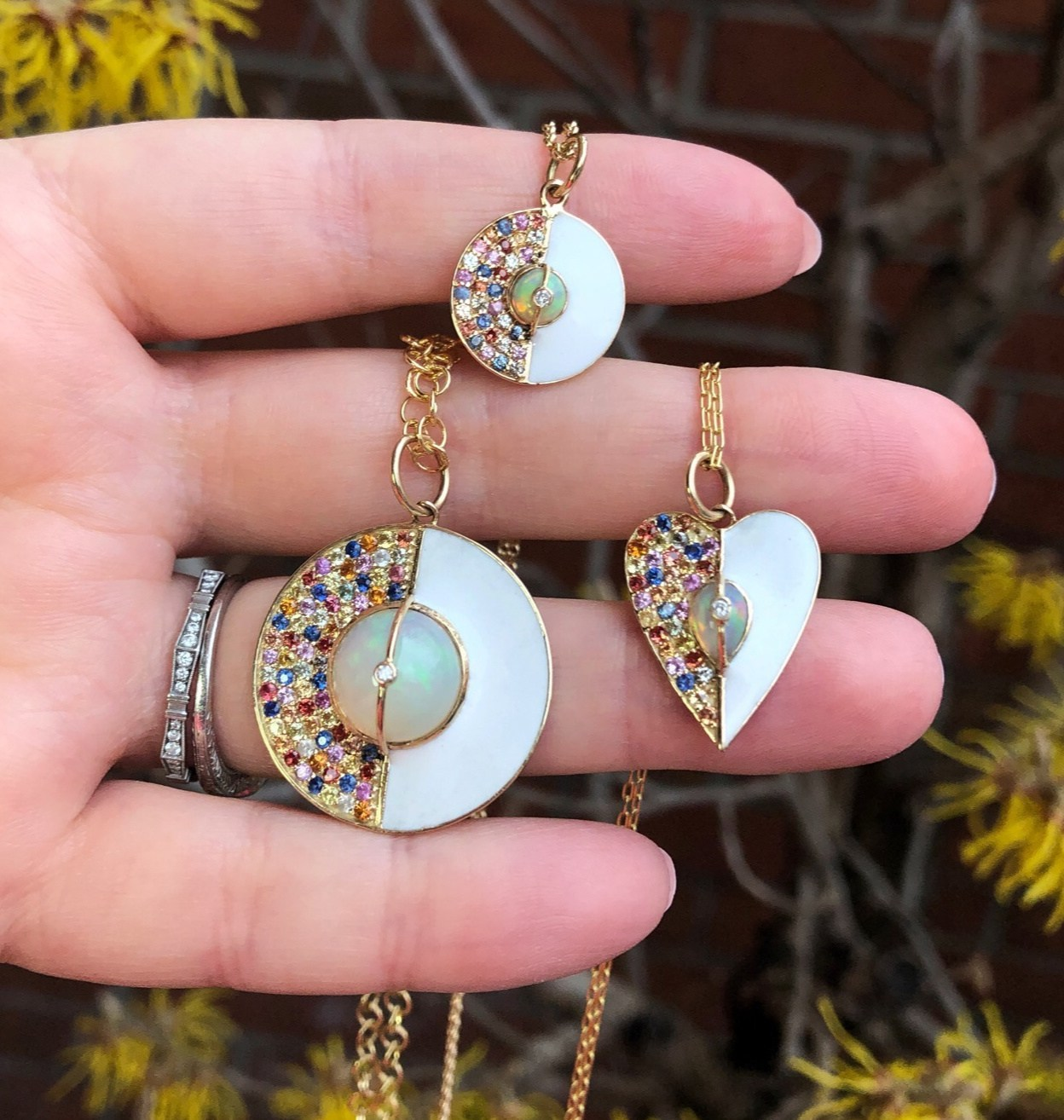 Beautiful necklaces from Loriann Jewelry's new Unity Collection! Colorful sappphires, white enamel, and a opal in gold.