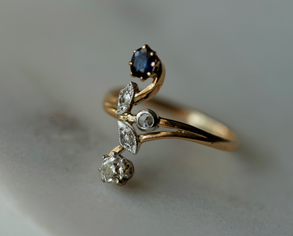 A beautiful antique ring with diamonds and a sapphire doublet.