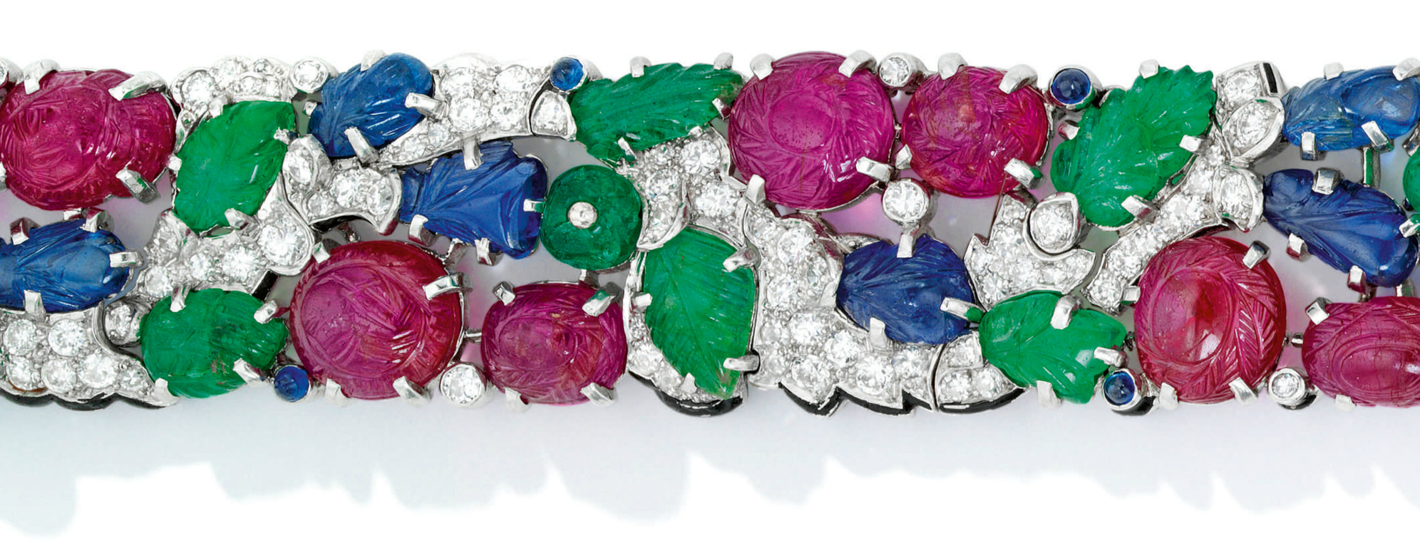A rare and beautiful Cartier Tutti Frutti bracelet; Art Deco era, circa 1930. Diamonds with carved rubies, emeralds, and sapphires. Detail view