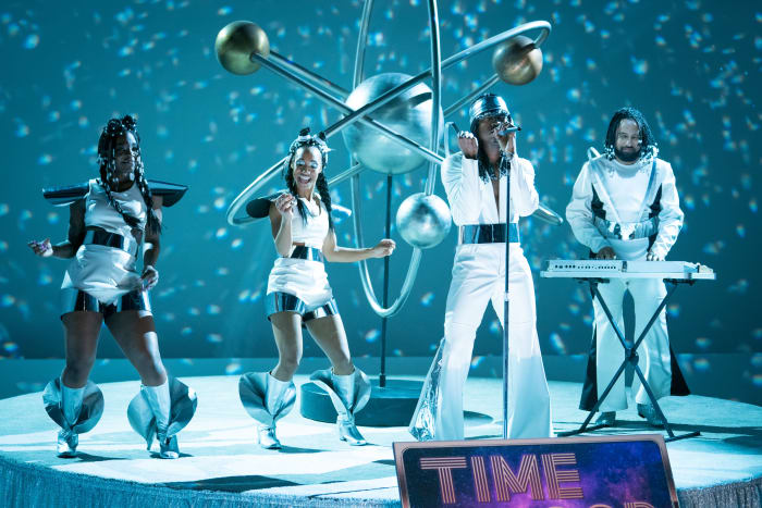 Ne-Yo (center) and Riddle (right) perform 'Time Loop' as Galaxia in season one, episode two. Wald-Cohain even had bubble-shaped helmets built, but despite the breathing holes, the clear plastic fogged up when they started singing. 'Which was a huge bummer,' she says.