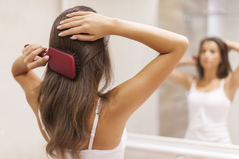 Digging hair out of your brush by the fistful? You may be losing more strands than you're regrowing. (Photo: Getty)