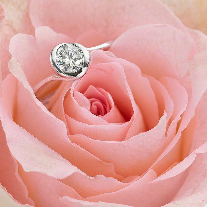 bezel set engagement ring in a rose design