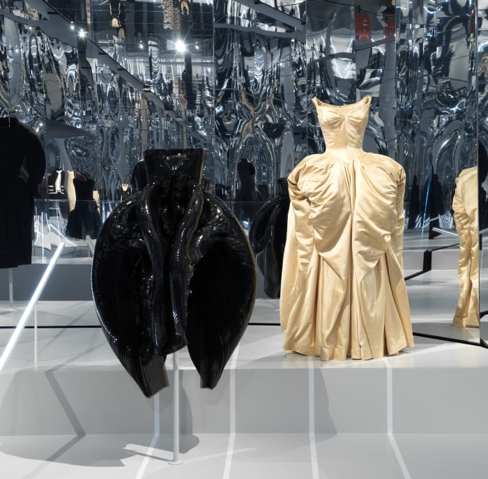 An Iris Van Herpen gown from Fall 2012, left, and a Charles James gown from 1951, right.