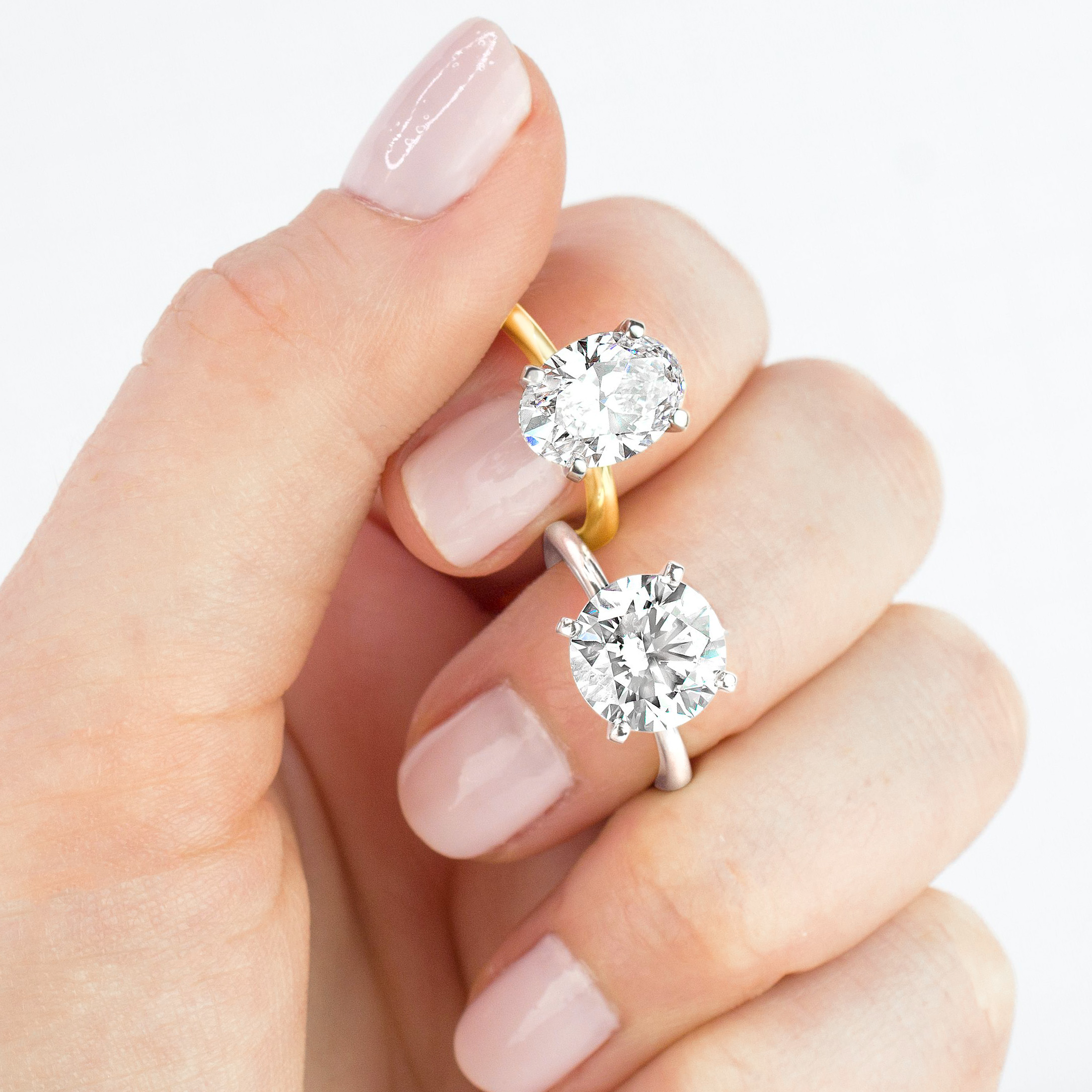 20190523-YG-WG-four-prong-petite-comfort-fit-ER-round-oval-diamond-model-on-hand-solitaire-classic-mixed-in-house-image.jpg