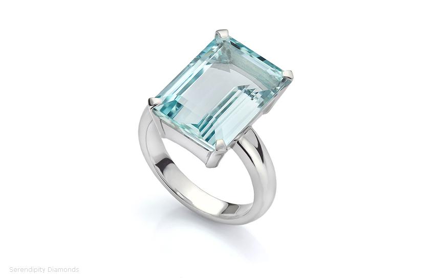 Bespoke ring featuring a solitaire Emerald cut Aquamarine