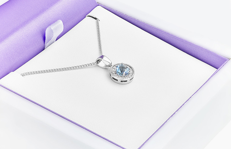 The something blue pendant shown in its box ready to be sent.