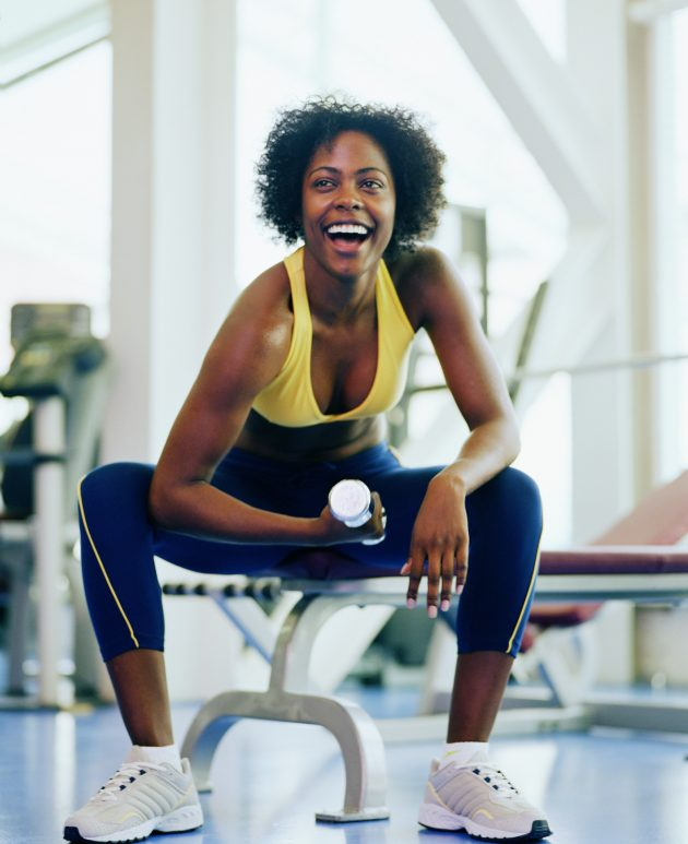 Gym anxiety: a woman working out in a gym