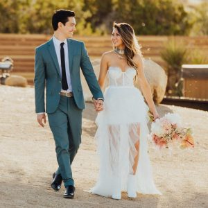 newly wed couple walking outside